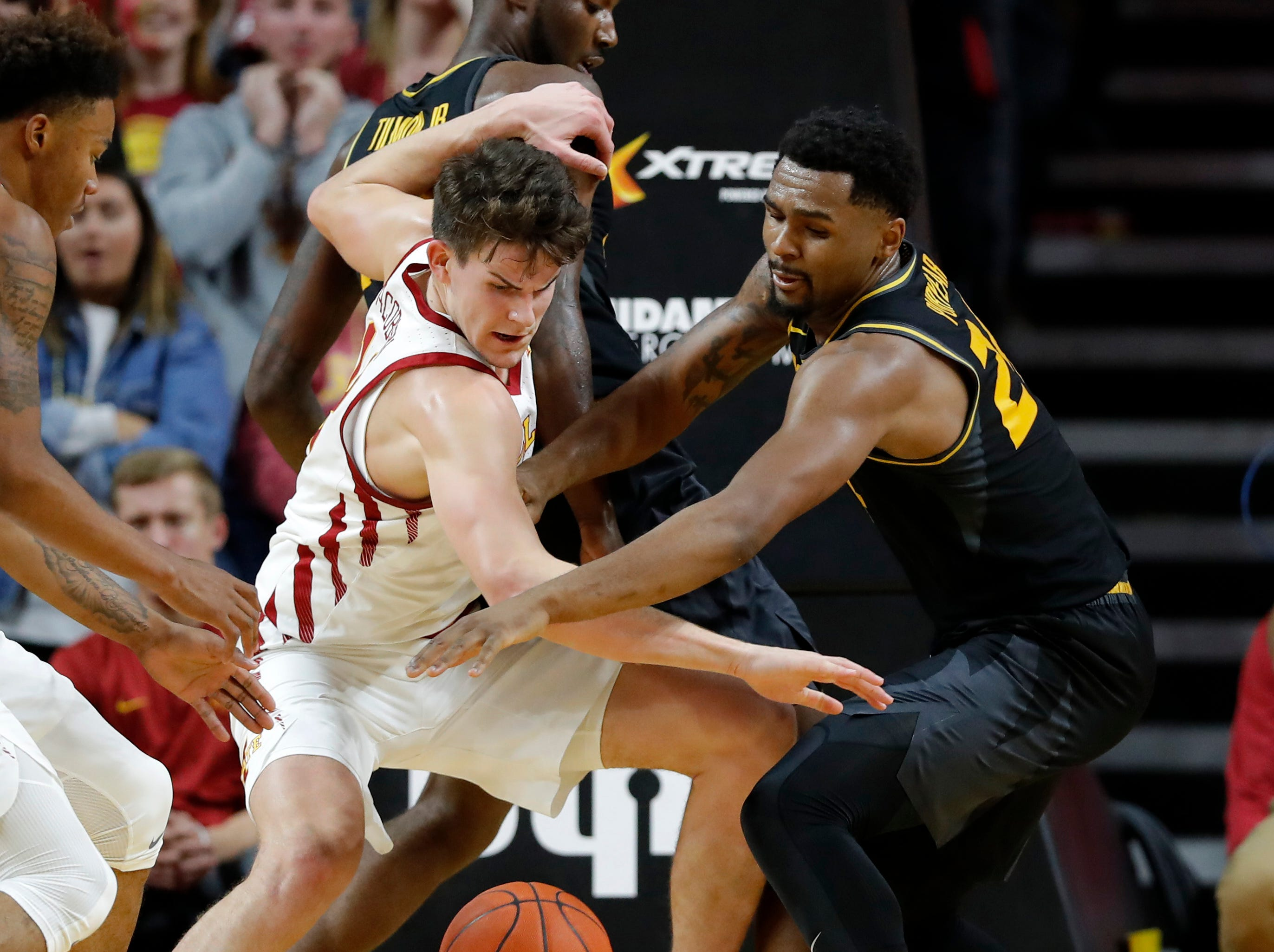 Iowa State forward Michael Jacobson, left, fights for a loose ball with Missouri forward Kevin Puryear during the first half of an NCAA college basketball game, Friday, Nov. 9, 2018, in Ames, Iowa.