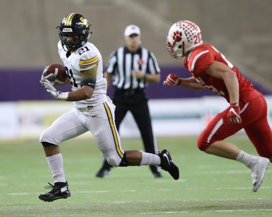 Nov 9, 2018; Cedar Falls, IA, USA; The Cedar Falls Tigers defense chases down Southeast Polk Rams Gavin Williams (21) at UNI Dome. The Rams lost to the Tigers 26-12.