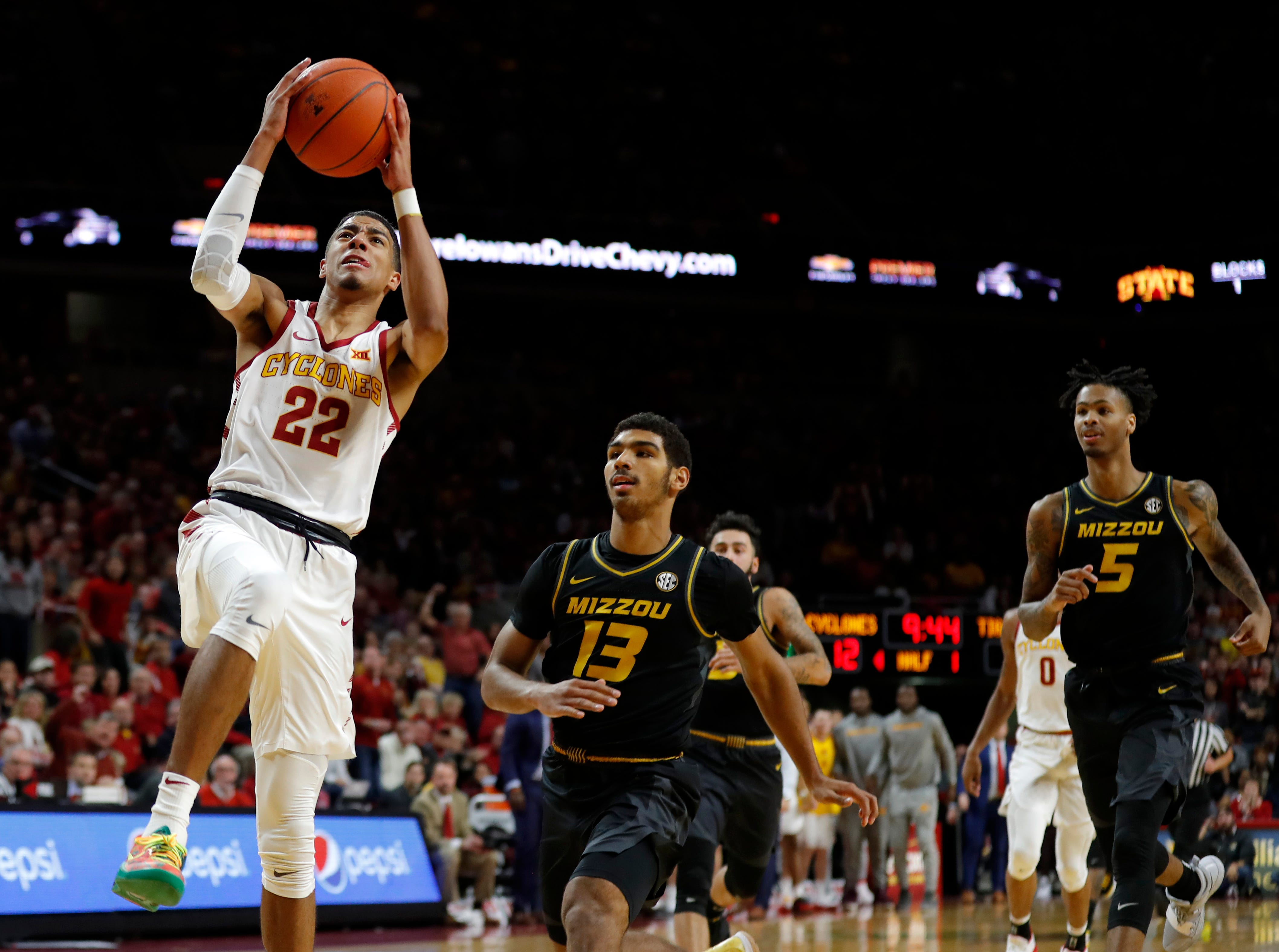 Iowa State guard Tyrese Haliburton (22) drives to the basket ahead of Missouri's Mark Smith (13) and Mitchell Smith (5) during the first half of an NCAA college basketball game, Friday, Nov. 9, 2018, in Ames, Iowa.