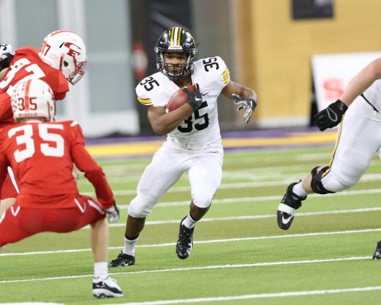 Nov 9, 2018; Cedar Falls, IA, USA; Southeast Polk Rams Deveyon Montgomery (35) looks for running room against the Cedar Falls Tigers at UNI Dome. The Rams lost to the Tigers 26-12.