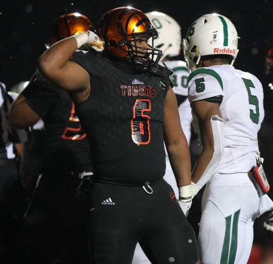 Belleville's Jalen Hunt celebrates his sack last season vs. West Bloomfield