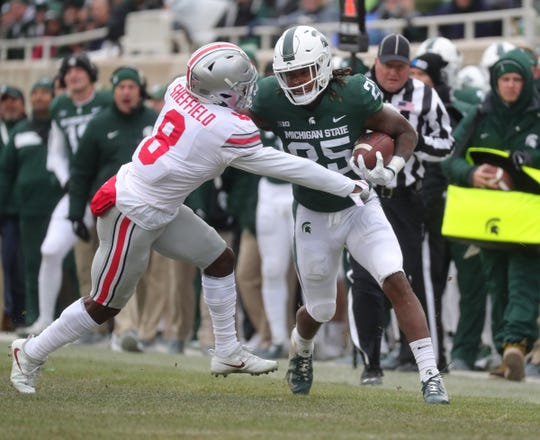 Darrell Stewart Jr. is tackled by Ohio State's Kendall Sheffield last season at Spartan Stadium.