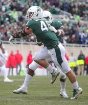 Michigan State DE Kenny Willekes celebrates his sack with Andrew Dowell during the first half of the 26-6 loss to Ohio State on Saturday, Nov. 10, 2018, in East Lansing.
