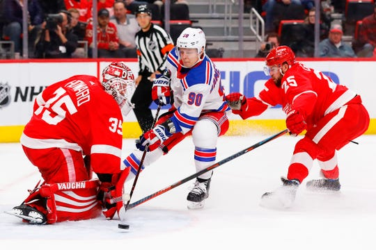 Detroit Red Wings goaltender Jimmy Howard makes the save on New York Rangers center Vladislav Namestnikov, as Red Wings defenseman Mike Green defends in the first period at Little Caesars Arena, Nov. 9, 2018.