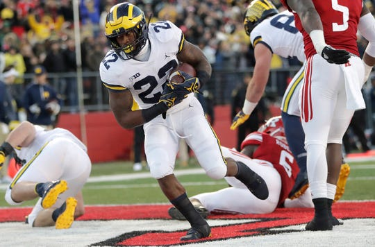 Michigan running back Karan Higdon scores a touchdown against Rutgers during the first half on Saturday, Nov. 10, 2018, in Piscataway, N.J.