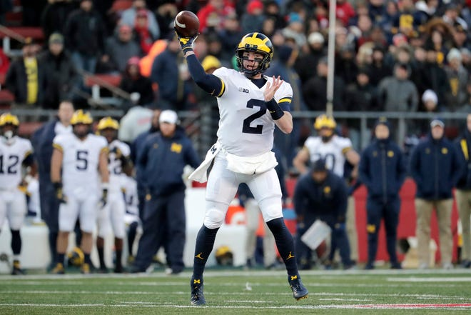 Michigan quarterback Shea Patterson looks to pass against Rutgers in the first half Saturday in Piscataway, N.J.