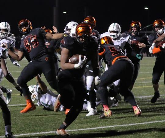 Belleville's Jalen Hunt scores the game-winning touchdown against West Bloomfield Friday, November 9, 2018 at Belleville High School in Belleville, Mich.