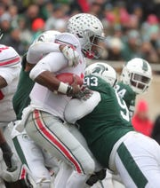 Michigan State's Justin Lane (2) and Naquan Jones (93) sack Ohio State's Dwayne Haskins Jr. during the first half on Saturday, Nov. 10, 2018, in East Lansing.