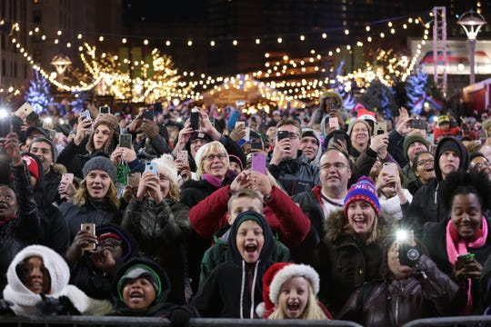 The crowd cheered as the lights went on at last year's tree-lighting ceremony at Campus Martius.