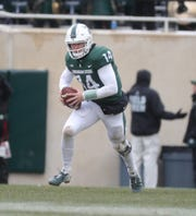 Michigan State QB Brian Lewerke runs the ball during the first half of the 26-6 loss to Ohio State on Saturday, Nov. 10, 2018, in East Lansing.