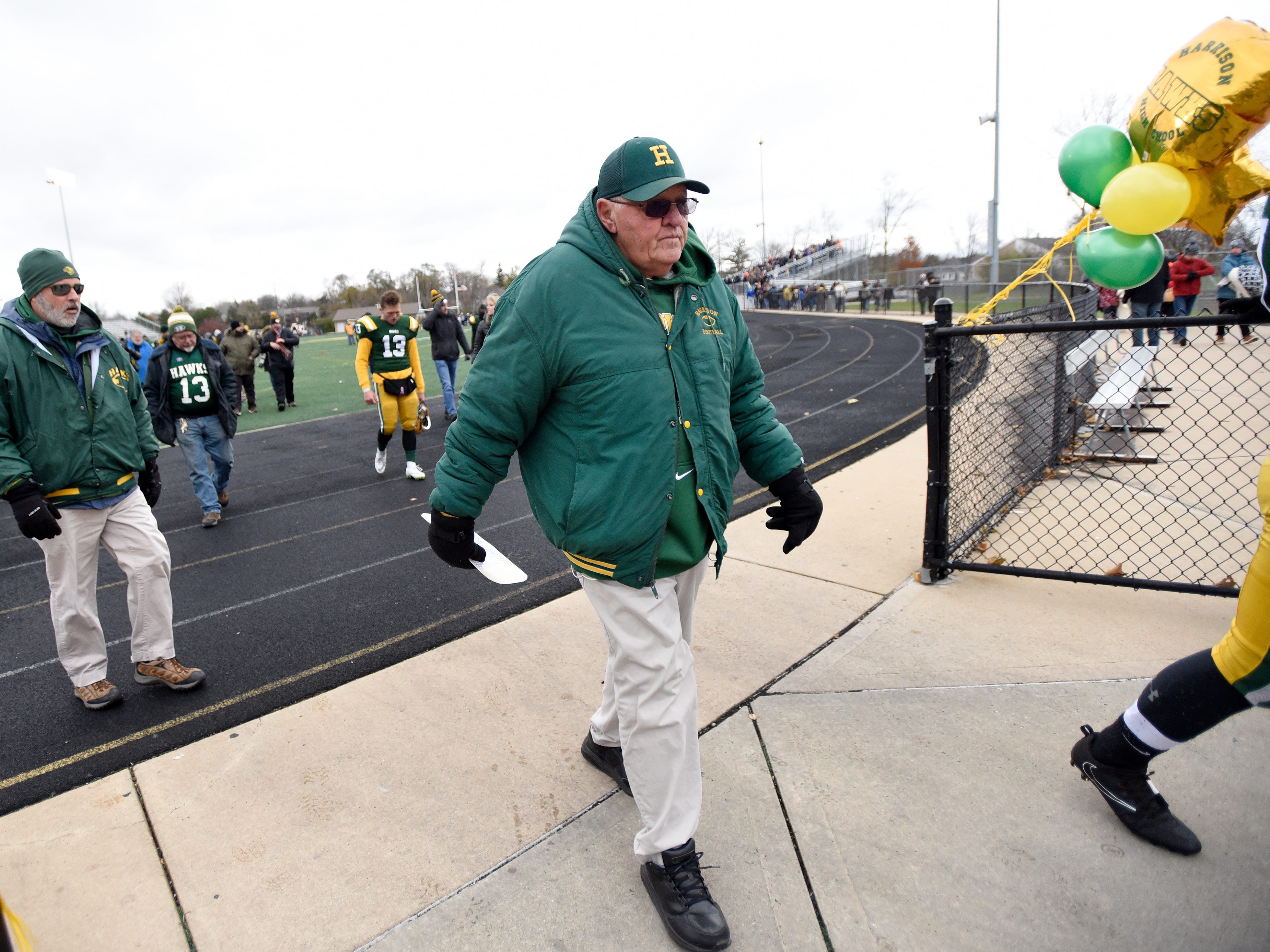 Legendary Farmington Hills Harrison football head coach John Herrington walks off the football field for the last time after his team lost to Chelsea.  The school will close in 2019.