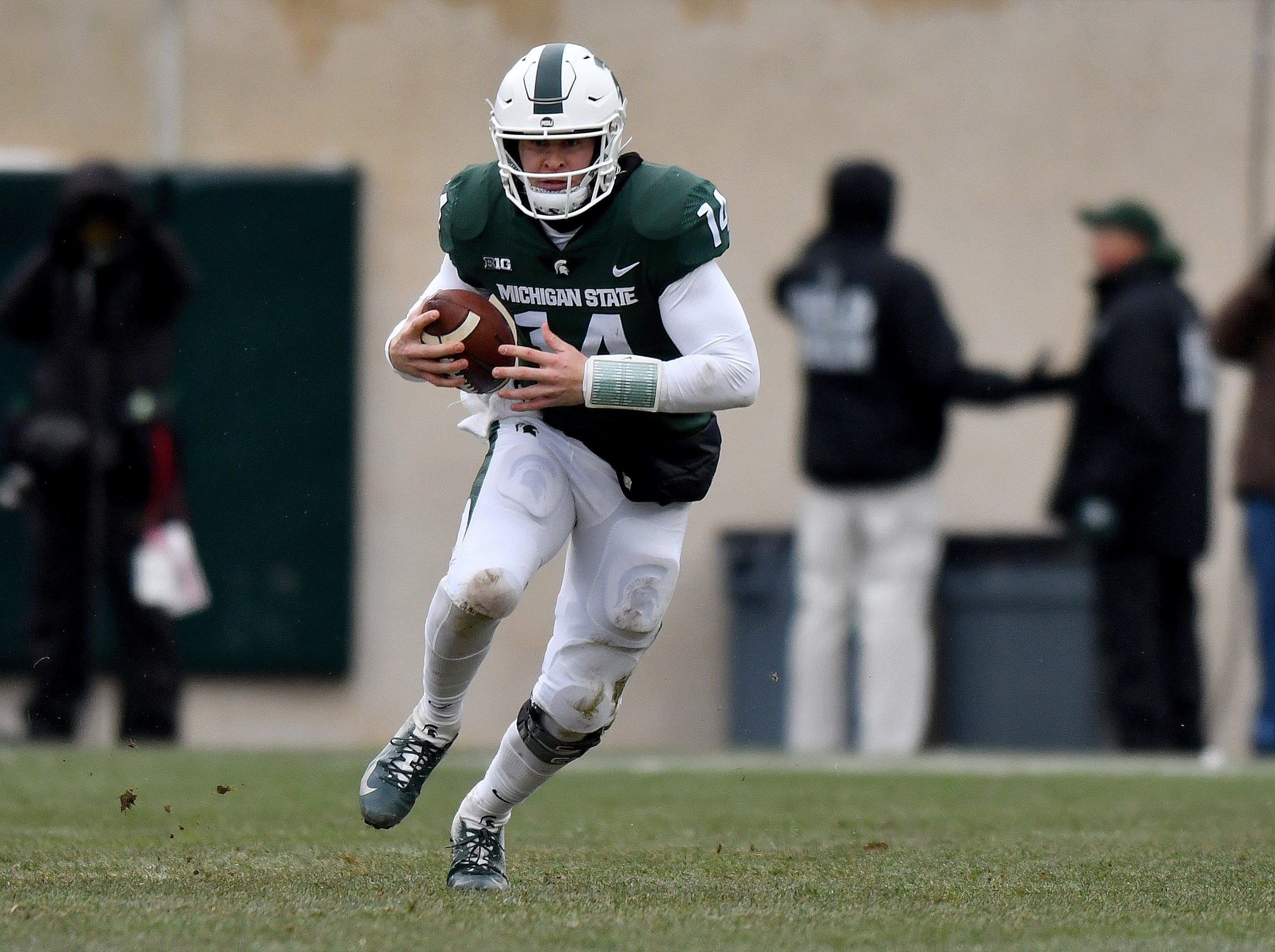 Brian Lewerke sprints upfield for seven yards in the second quarter.