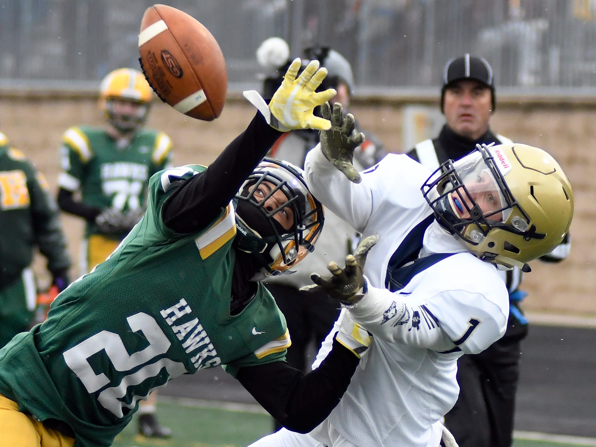 Farmington Hills Harrison defensive back Xavier Goldsmith (20) knocks the ball away from Chelsea wide receiver Kyle Knight (1) in the fourth quarter.