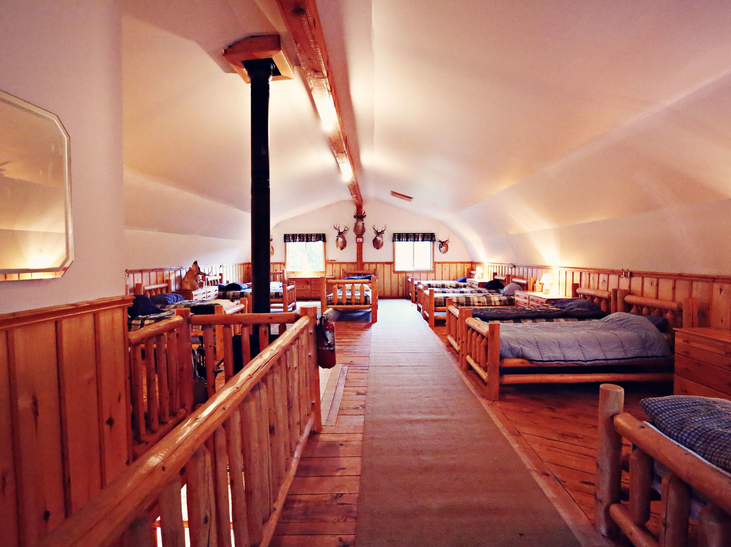 In addition, a two-story club house called the Antler's Inn sits down the road from the lake house. The house has a full kitchen, pool table, shuffle board table and a fireplace. The inn's second-floor has a full bathroom, a wood-burning stove and can sleep 14 comfortably.