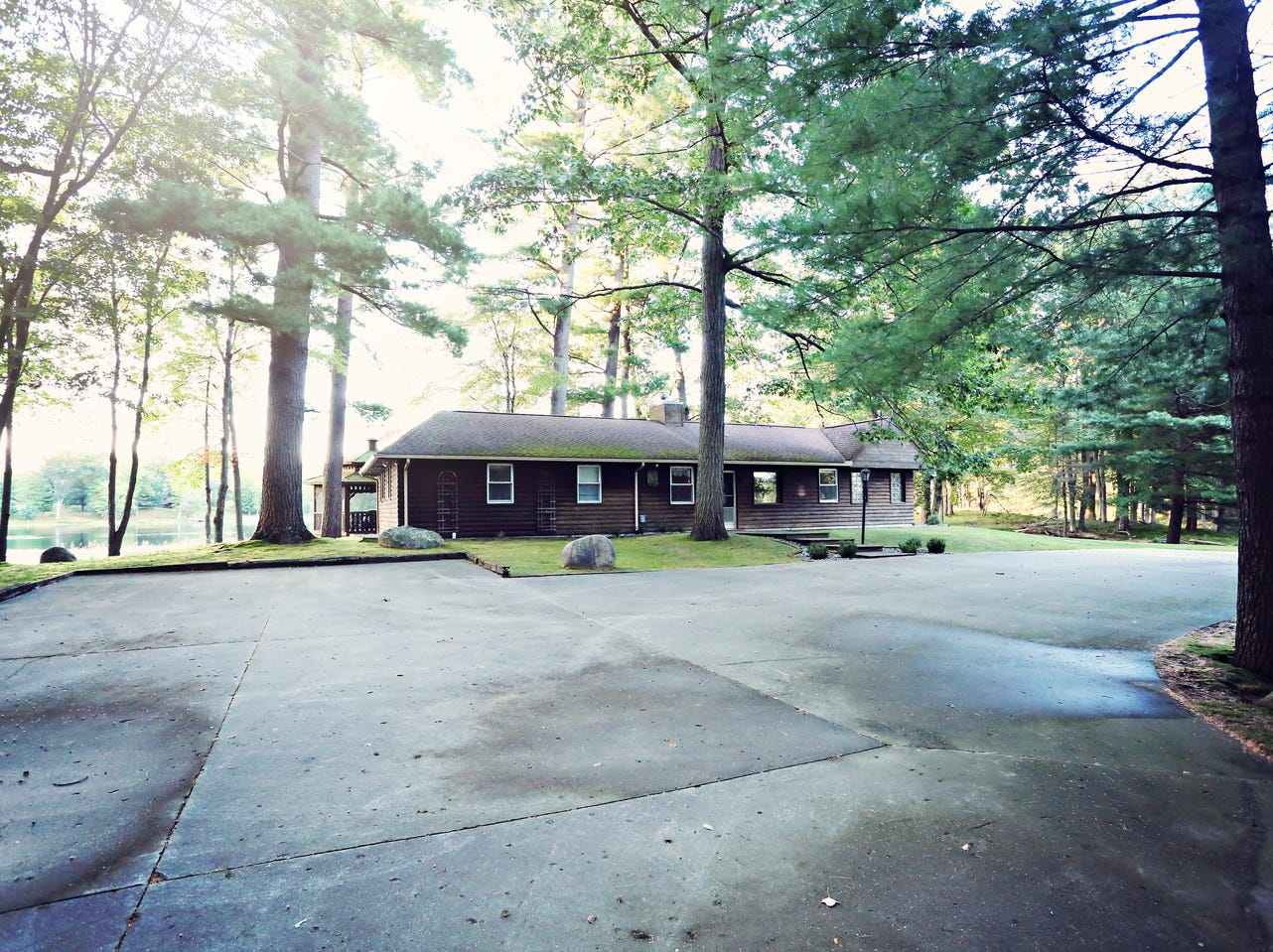 A 1,200 square-foot guest house sits on the southern edge of the south lake. The original home on the property, it has three bedrooms and three bathrooms.