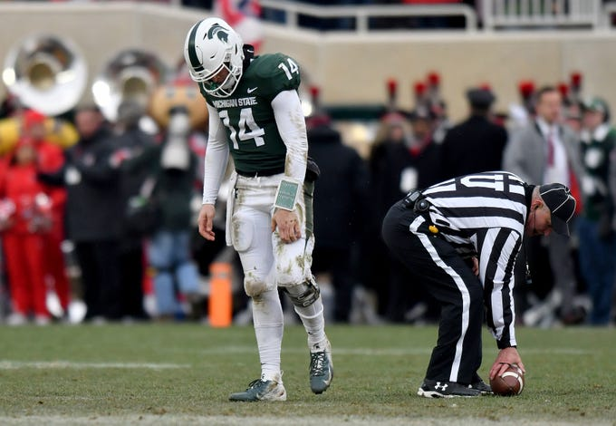 Brian Lewerke leaves the field in with his head down, after one of his fourth-quarter passes was intercepted. MSU fell to Ohio State 26-6 on Saturday, Nov. 10, 2018 at Spartan Stadium in East Lansing.