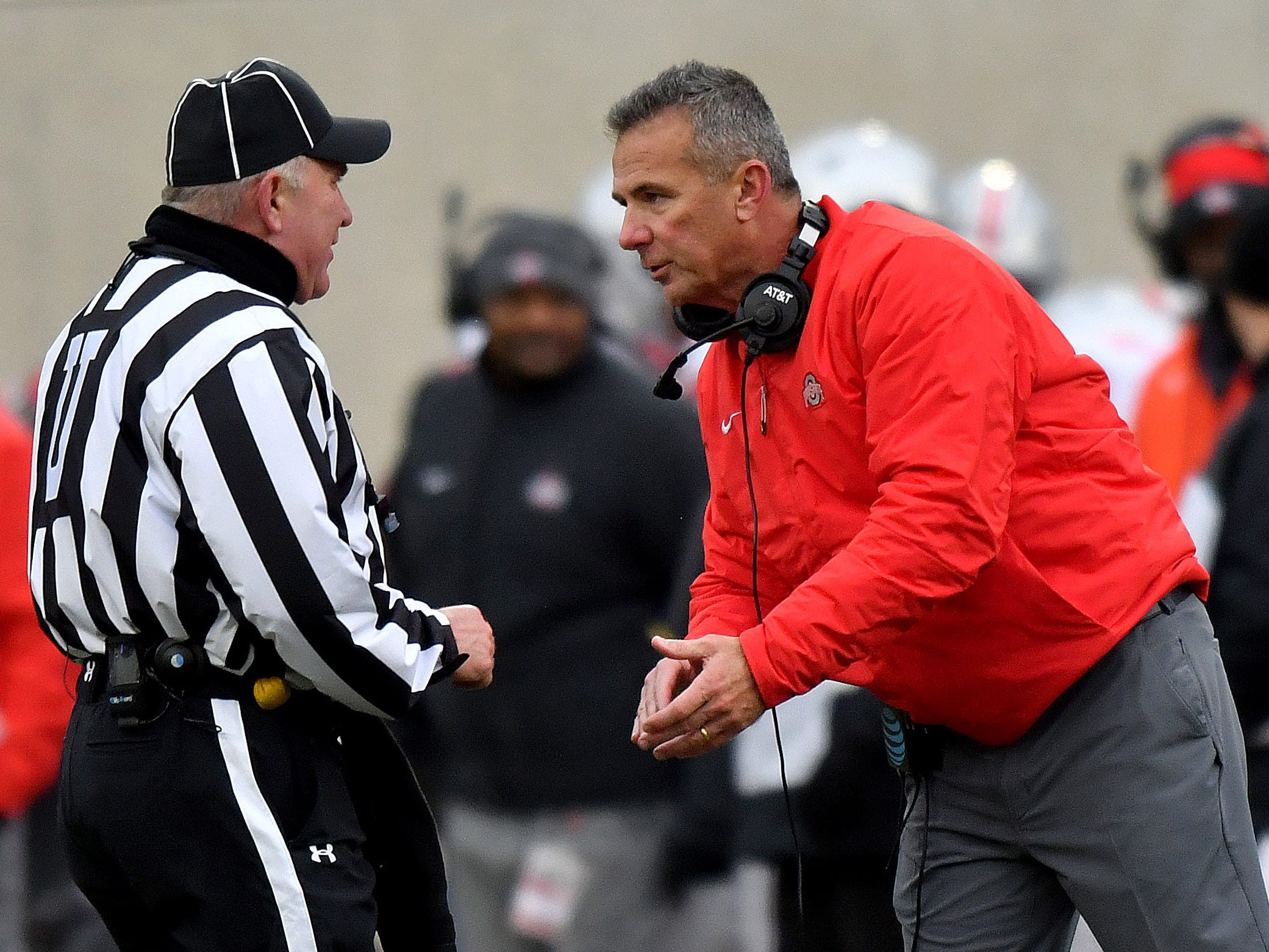 Buckeye head coach Urban Meyer has a word and a smile for one of the officials in the fourth quarter.