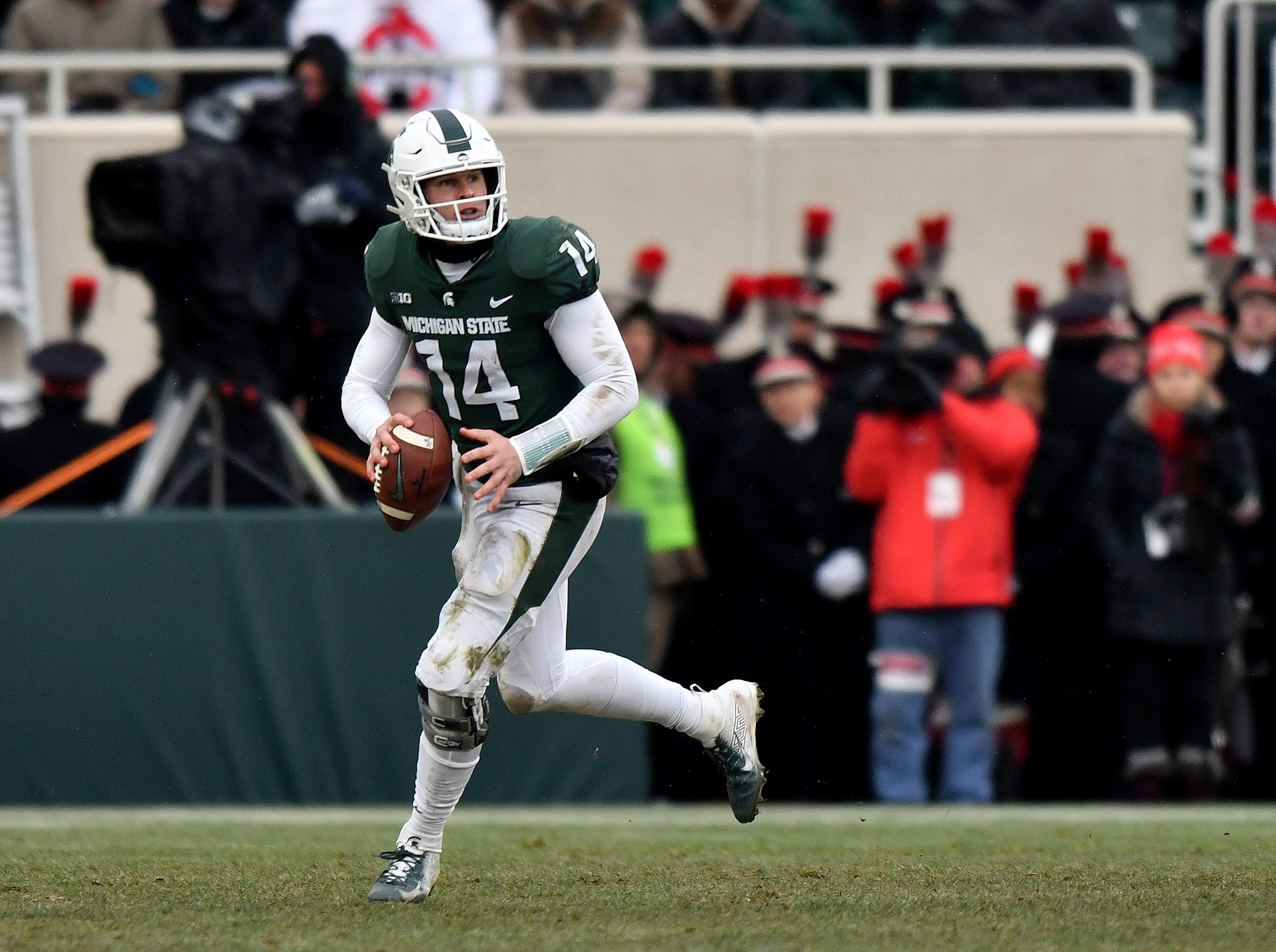 Brian Lewerke scrambles out of the pocket in the fourth quarter.