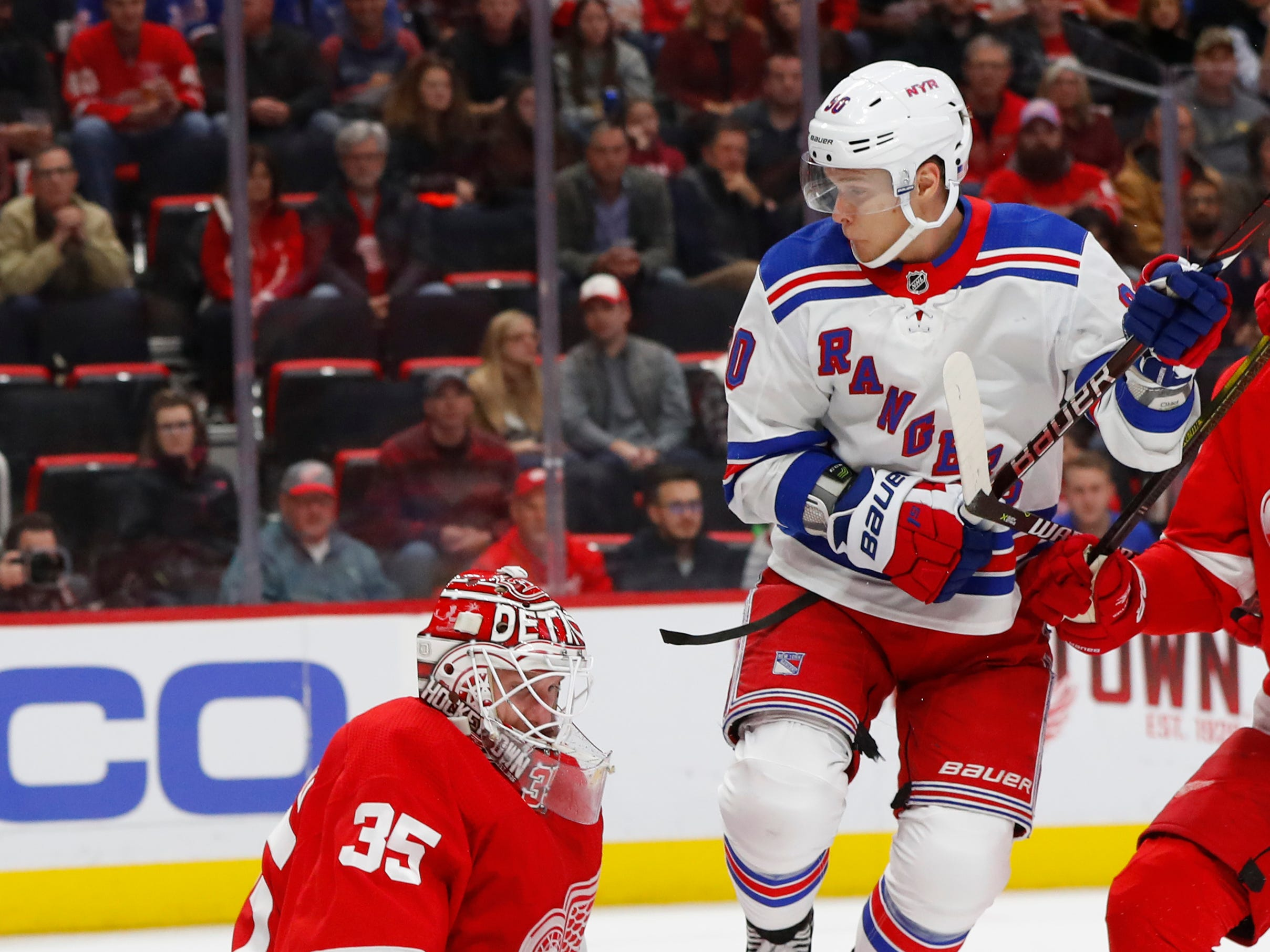 Detroit Red Wings goalie Jimmy Howard (35) stops a shot as New York Rangers' Vladislav Nameestnikov (90) jumps out of the way In the first period of an NHL hockey game in Detroit, Friday, Nov. 9, 2018.