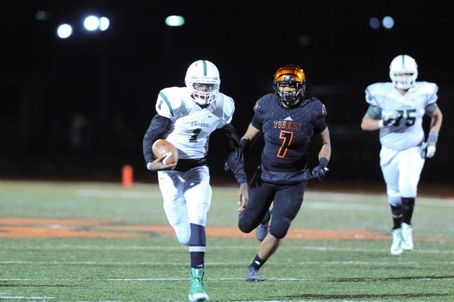 West Bloomfeild's C.J. Harris run the ball during Friday's night's regional game against Belleville.