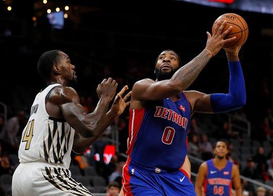 Andre Drummond of the Detroit Pistons attacks the basket against Dewayne Dedmon of the Atlanta Hawks Friday at State Farm Arena in Atlanta.