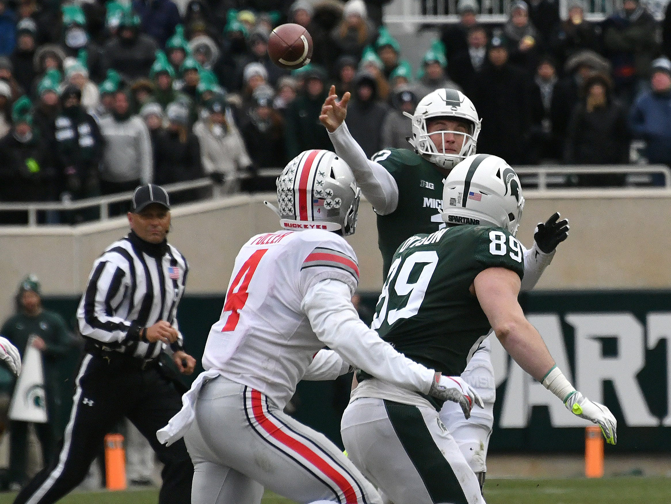 Rocky Lombardi throws at Spartan tight end Matt Dotson in the third quarter.