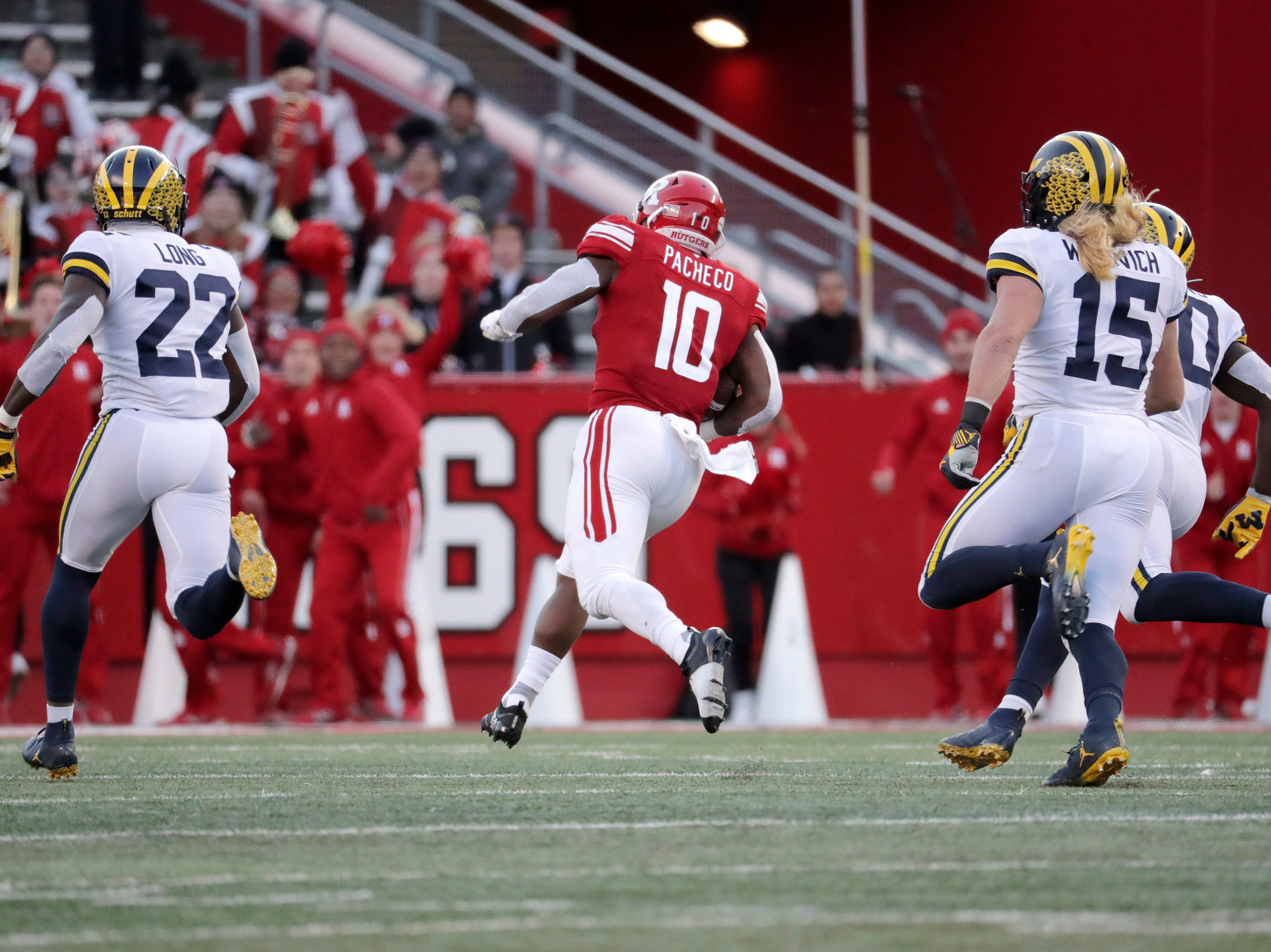 Rutgers running back Isaih Pacheco (10) breaks free for a long touchdown run as Michigan's David Long (22) and Chase Winovich (15) pursue.