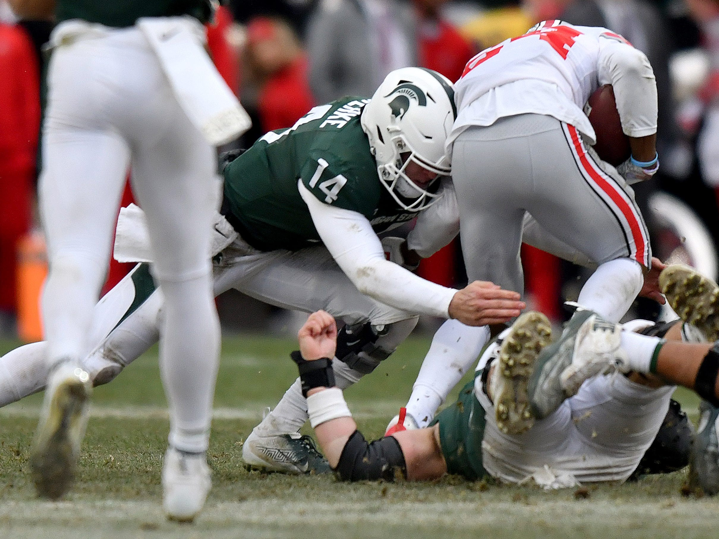 Spartan quarterback Brian Lewerke is forced to make a tackle after one of his passes was intercepted in the fourth quarter.