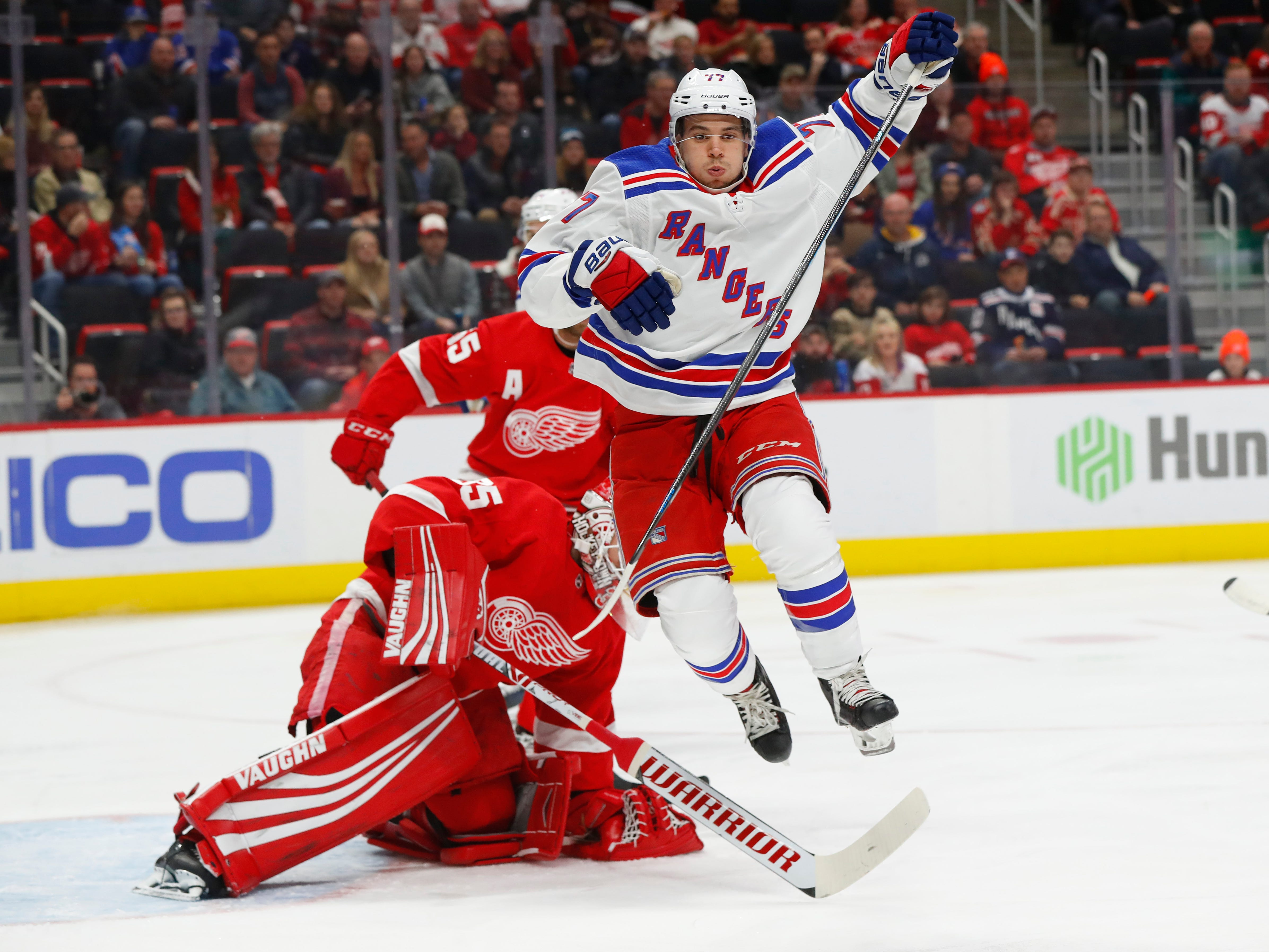 Detroit Red Wings goalie Jimmy Howard stops a shot by New York Rangers' Tony DeAngelo in the first period of an NHL hockey game in Detroit, Friday, Nov. 9, 2018.