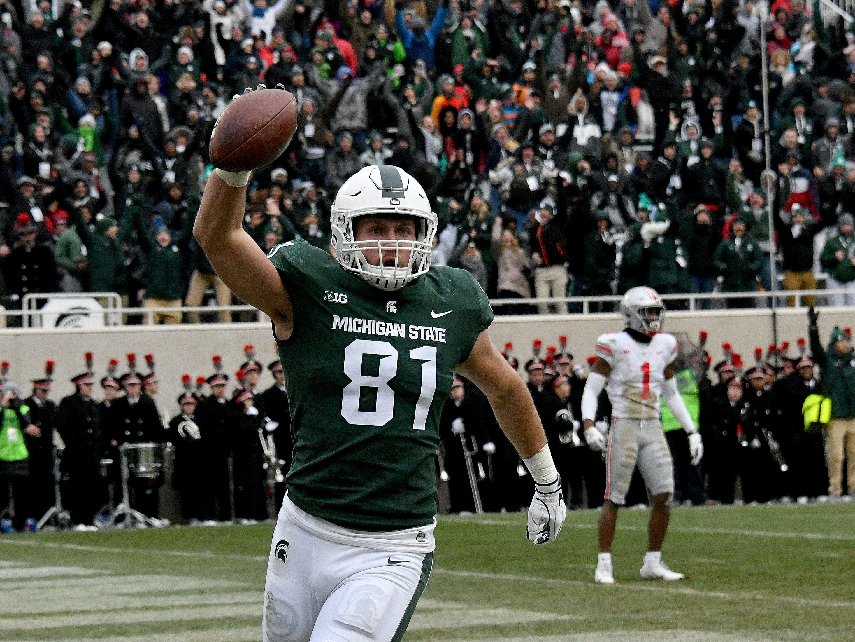 Matt Sokol celebrates after he catches the ball in the end zone in the third quarter in a play that would have put the Spartans in the lead, but the touchdown was negated by the referees .