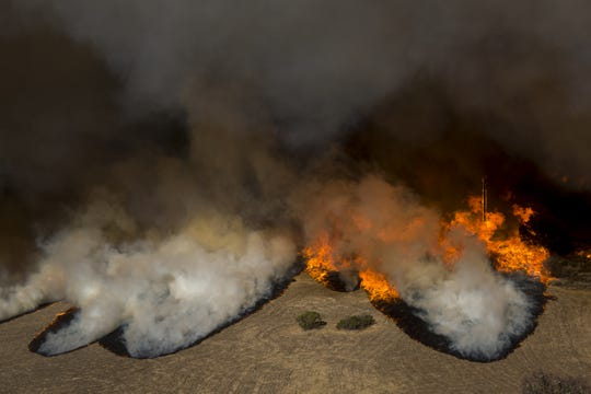 Flames overtake the Reagan Ranch, once owned by President Ronald Reagan, at Malibu Creek State Park during the Woolsey Fire on Friday near Malibu, California.