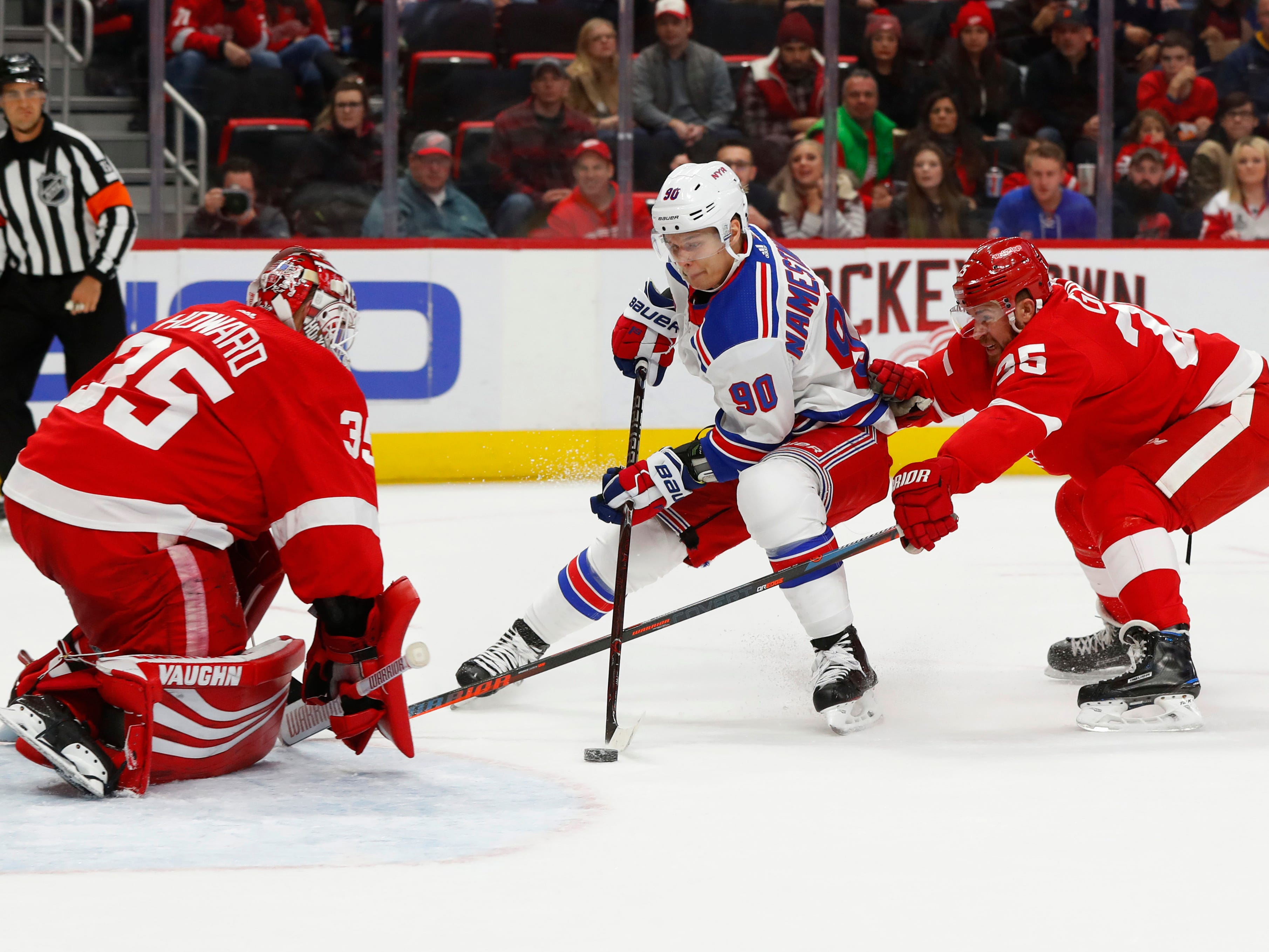 Detroit Red Wings goalie Jimmy Howard (35) stops a shot by New York Rangers' Vladislav Manestnikov (90) as Mike Green defends in the first period of an NHL hockey game in Detroit, Friday, Nov. 9, 2018.
