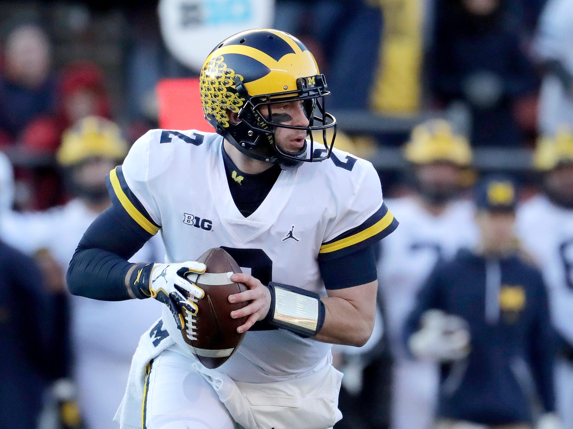 Michigan quarterback Shea Patterson looks to pass against Rutgers during the first half.