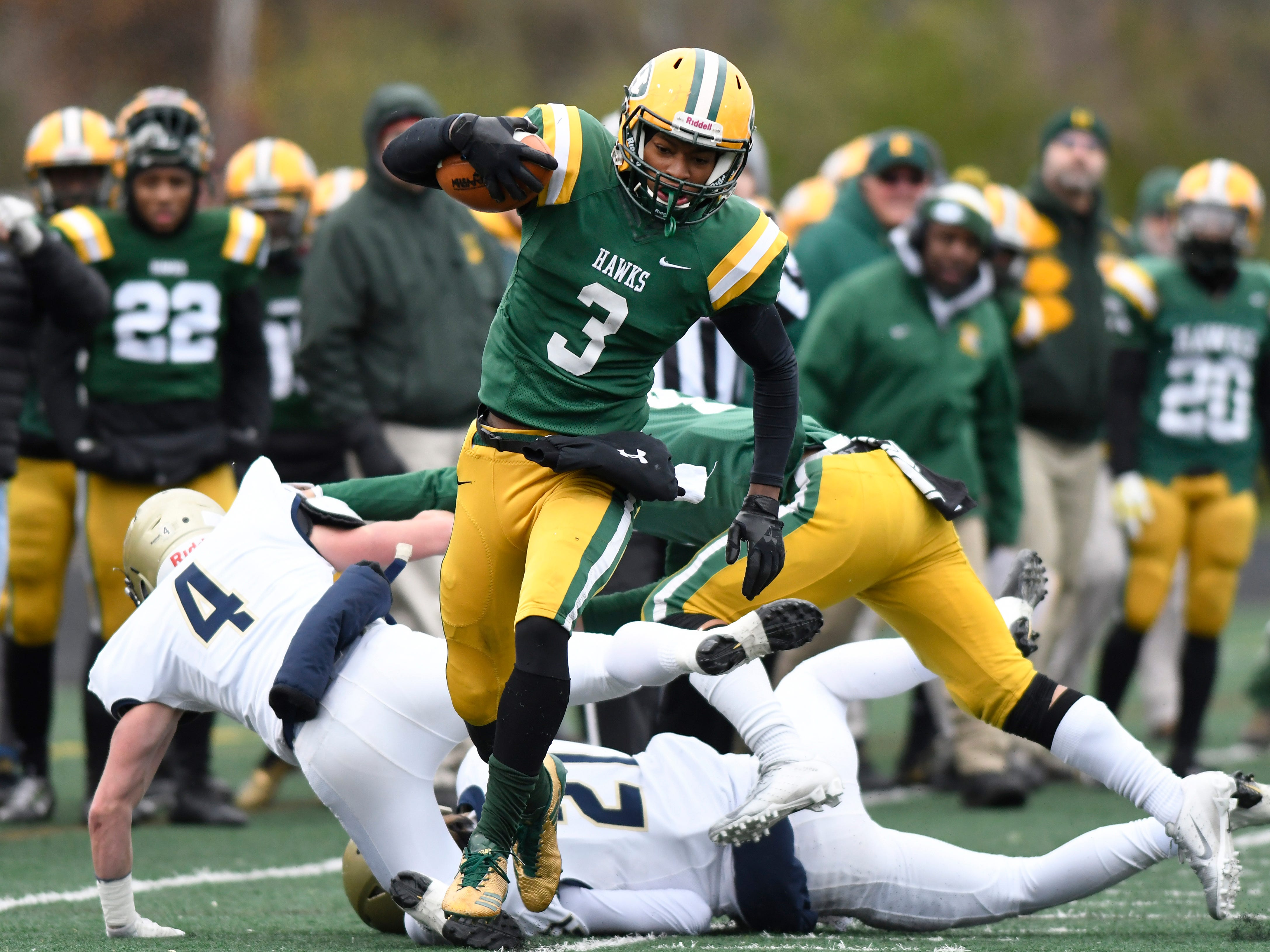 Farmington Hills Harrison running back Roderick Heard runs for a first down against Chelsea during the first quarter, Saturday in a Division 4 Regional Final played at Harrison High School in Farmington Hills.