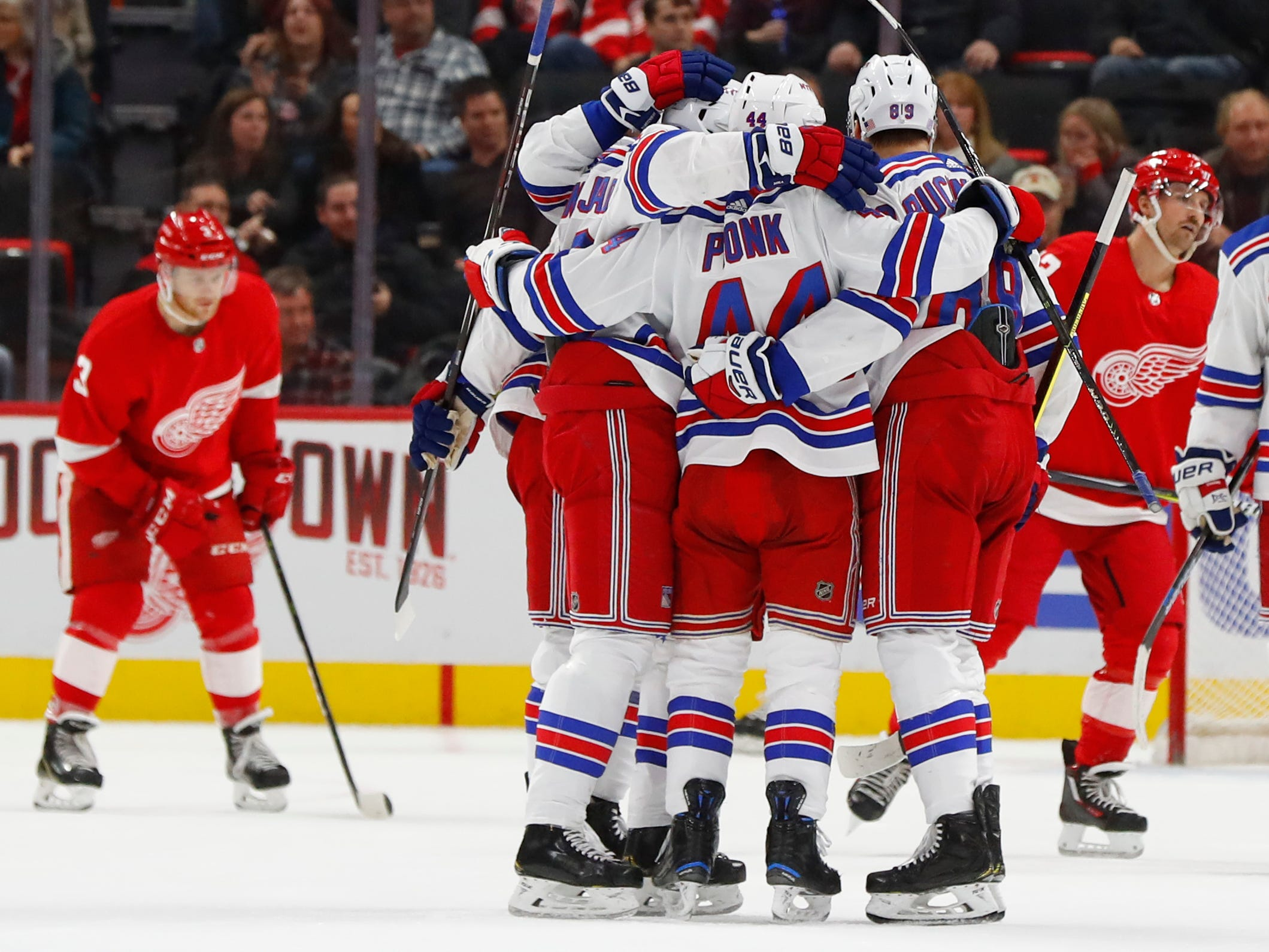 New York Rangers' Neal Pionk (44) celebrates his goal against the Detroit Red Wings in the second period of an NHL hockey game in Detroit, Friday, Nov. 9, 2018.