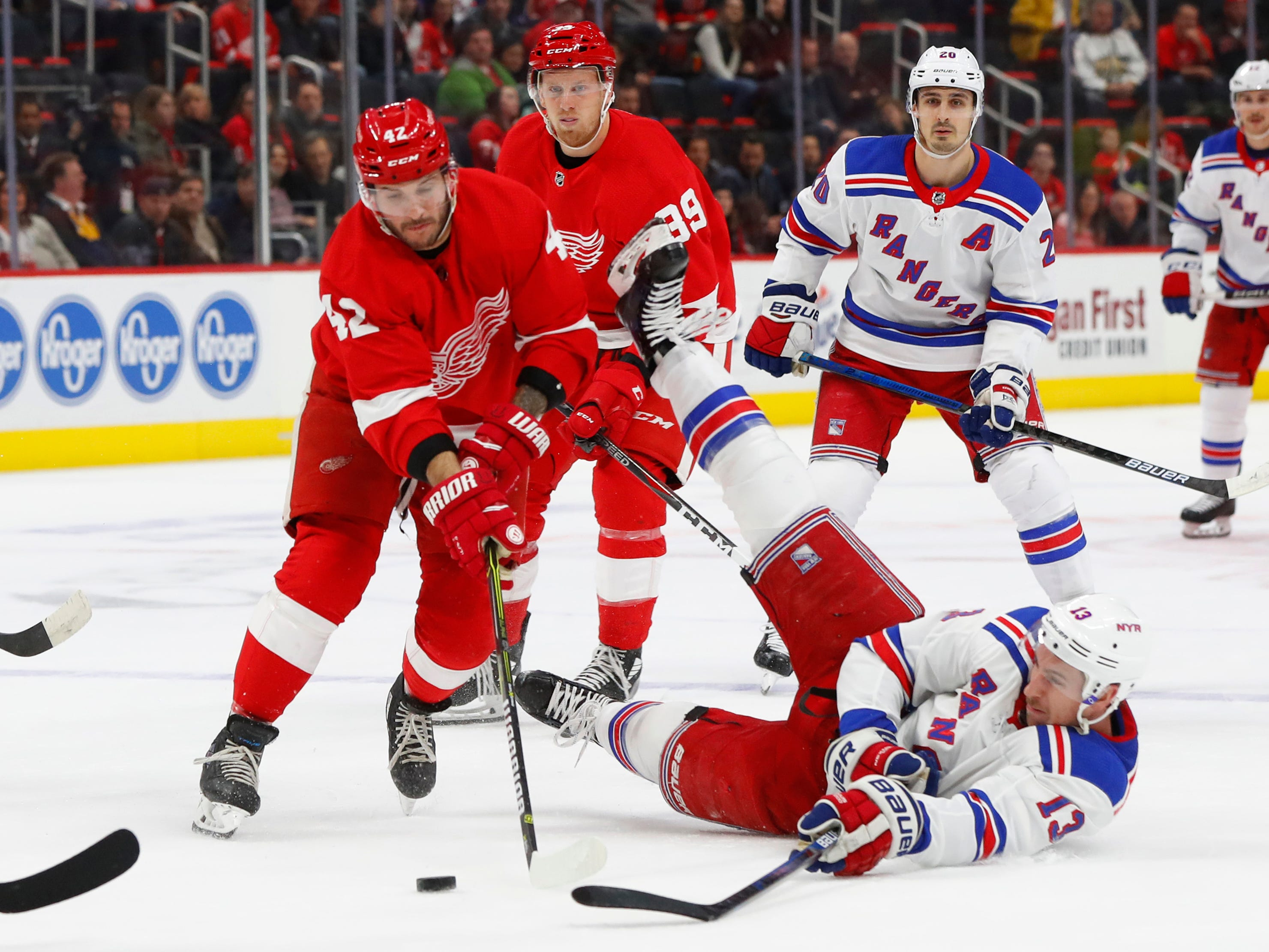 Detroit Red Wings' Martin Frk (42) and New York Rangers' Kevin Hayes (13) battle for the puck in the first period of an NHL hockey game in Detroit, Friday, Nov. 9, 2018.
