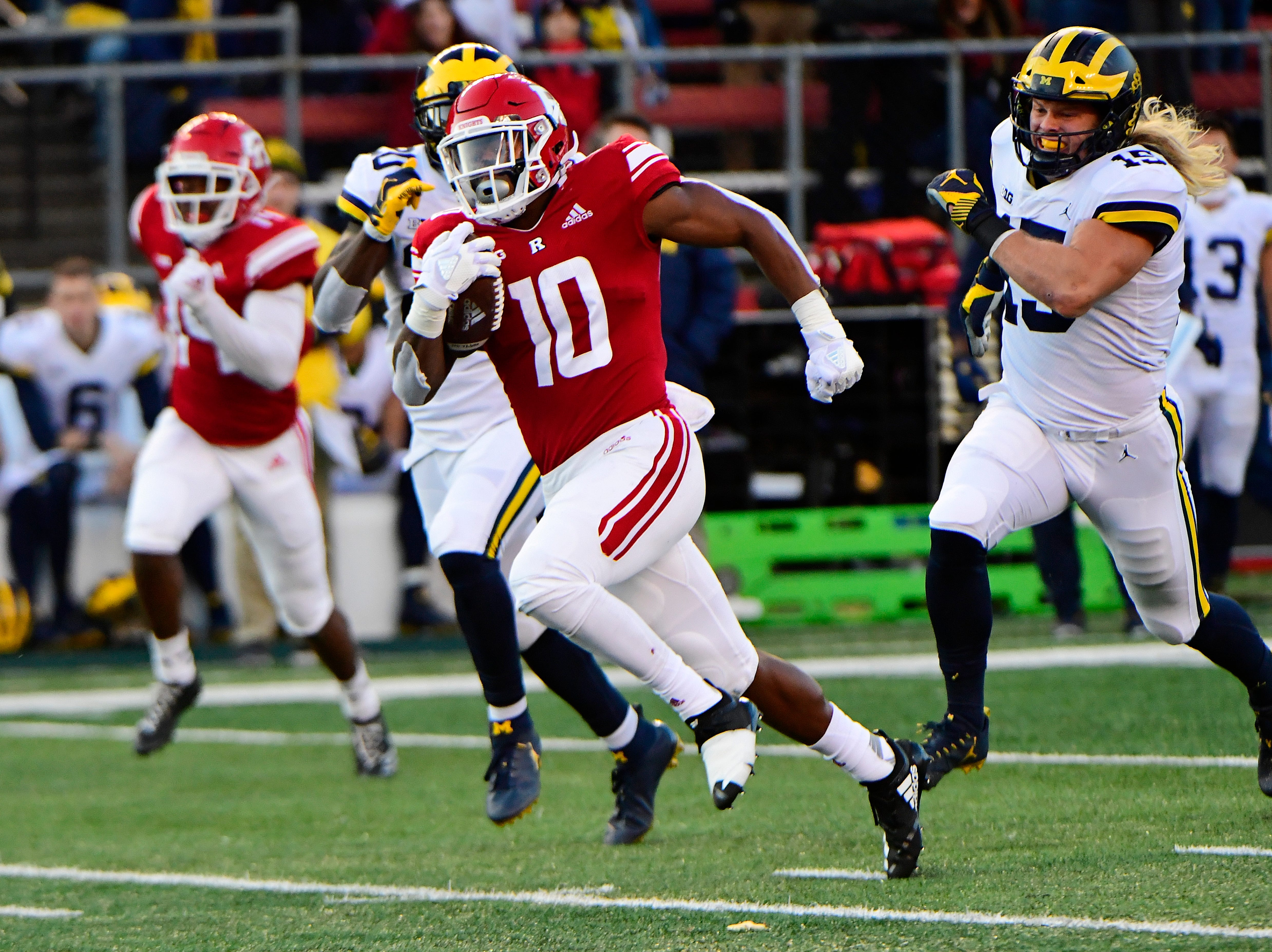 Isaih Pacheco of the Rutgers Scarlet Knights rushes for a touchdown against the Michigan Wolverines during the first quarter.