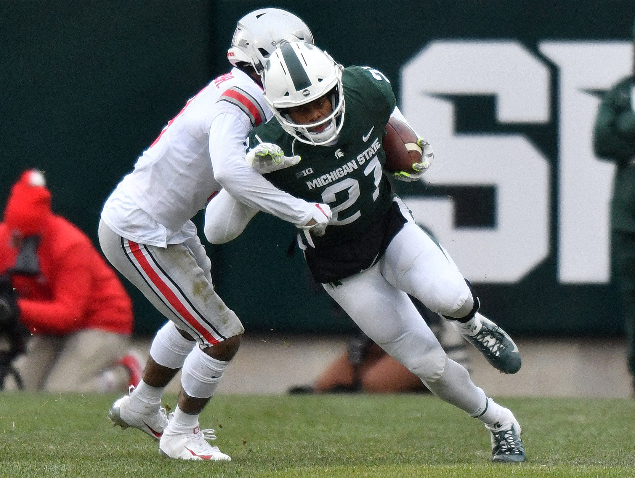Spartan Cam Chambers slips past a Buckeye tackler in the third quarter.