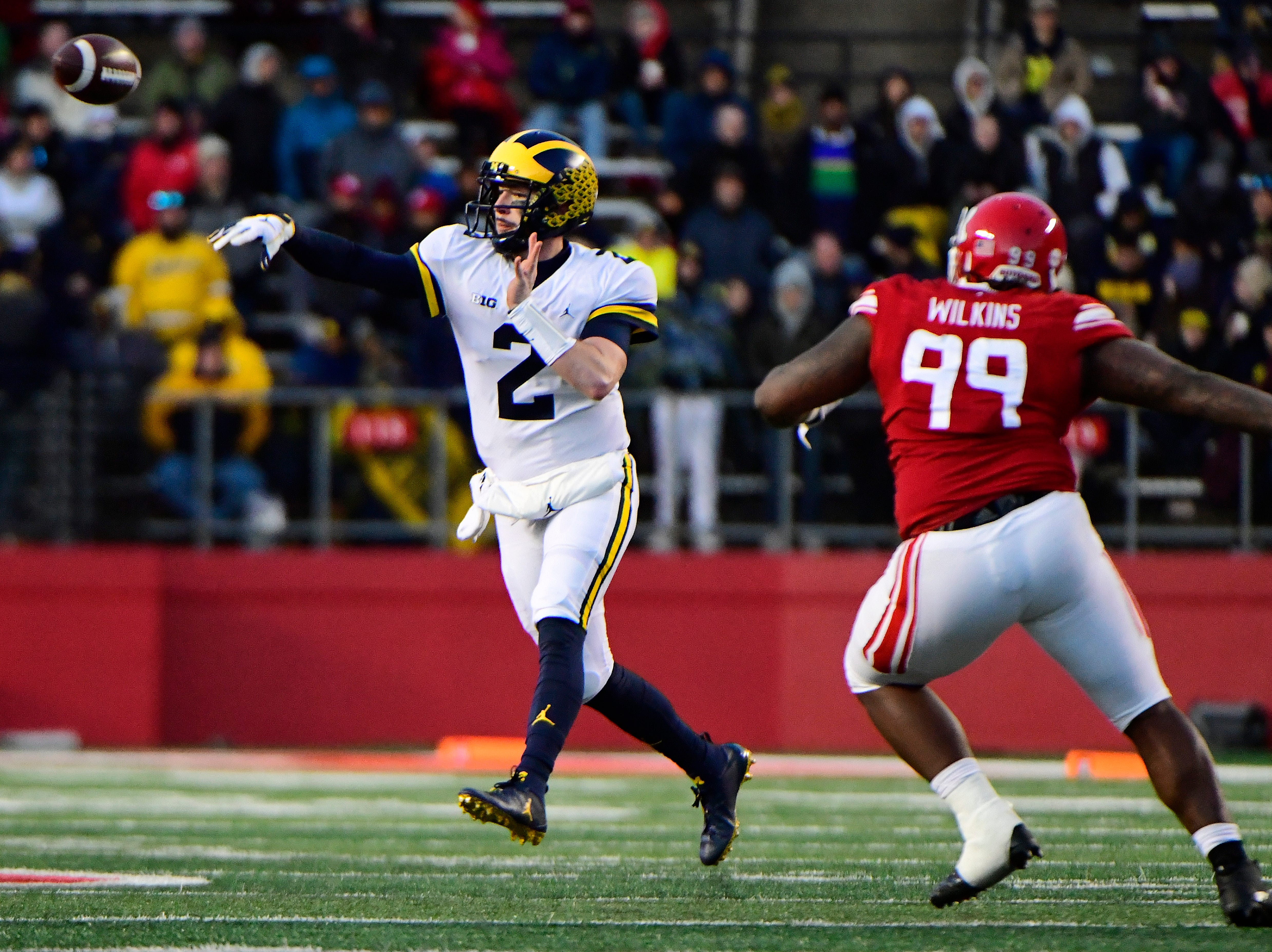Shea Patterson of the Michigan Wolverines throws against Kevin Wilkins of the Rutgers Scarlet Knights.