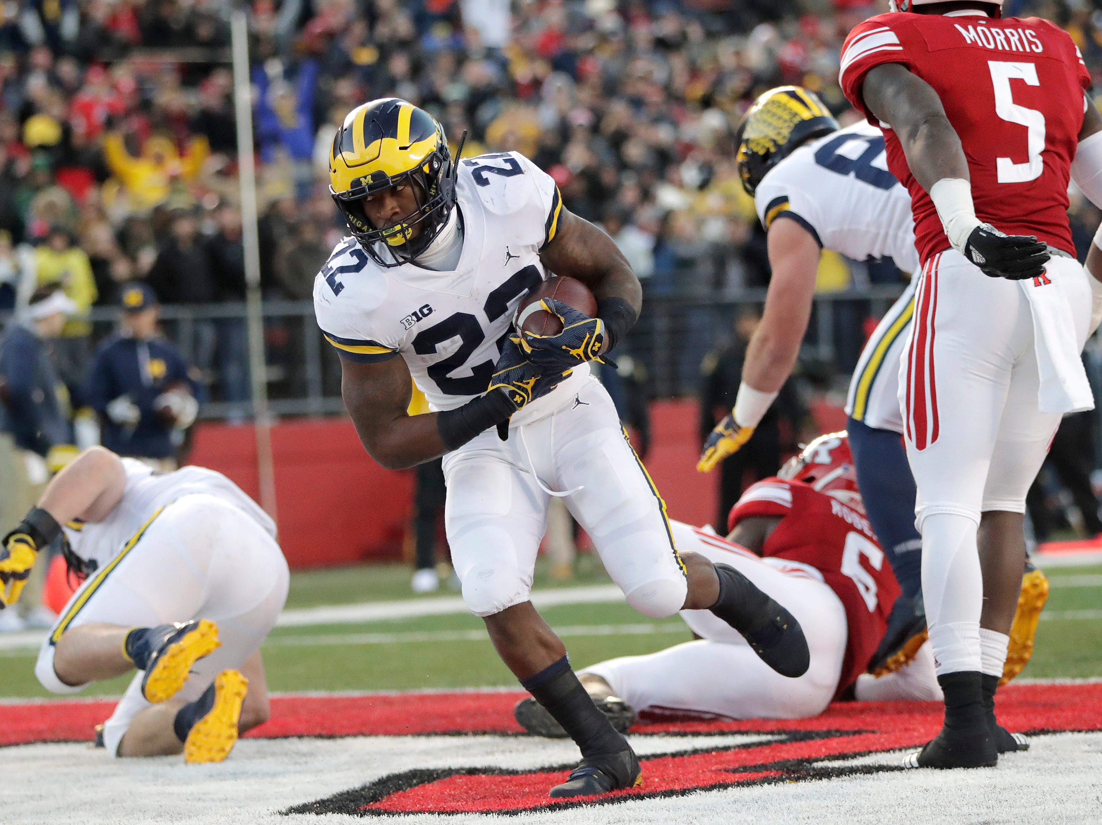 Michigan running back Karan Higdon  scores on a touchdown run against Rutgers.