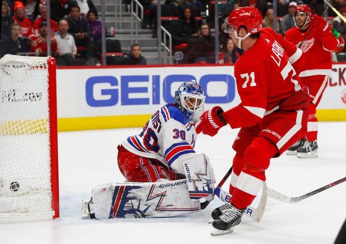 Detroit Red Wings' Dylan Larkin scores on New York Rangers goalie Henrik Lundqvist in overtime of an NHL hockey game in Detroit, Friday, Nov. 9, 2018. Detroit won 3-2. (