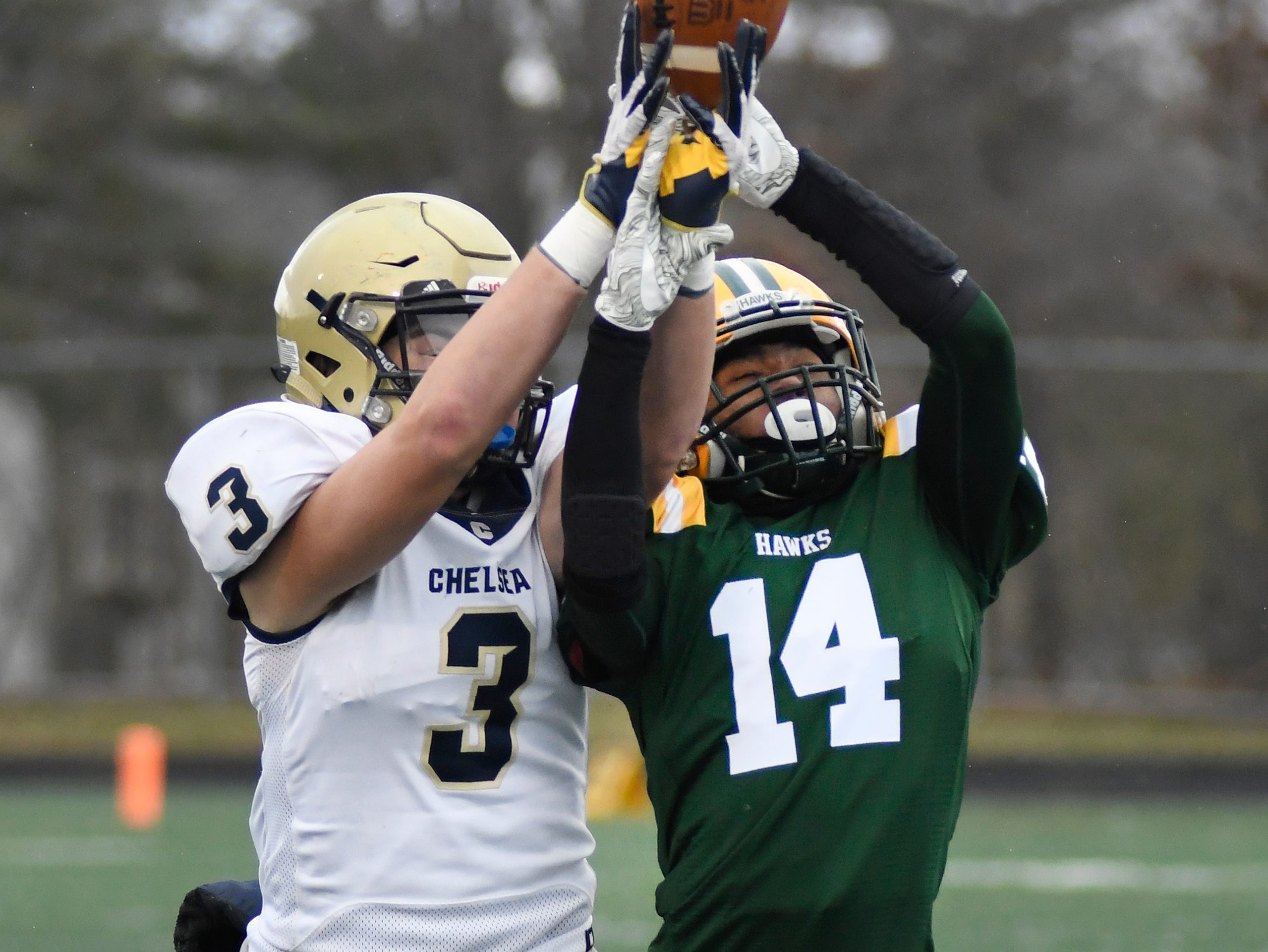 Chelsea tight end Nick Christian (3) has a pass knocked away from him by Farmington Hills Harrison defensive back Javair Beeler (14) in the fourth quarter.