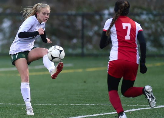 Vestal's Kaitlyn Cooke (8) looks to kick past Kayla Camacho (7) of Valley Stream South during Vestal vs. Valley Stream South, NYSPHSAA Girls Soccer Championship semifinal, Tompkins Cortland Community College, Dryden, NY. Saturday, November 10, 2018.