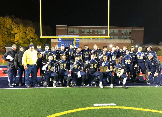 Elmira Notre Dame poses for a team photo after its 38-36 intersectional win over Tri-Valley on Nov. 9, 2018 at Binghamton Alumni Stadium.