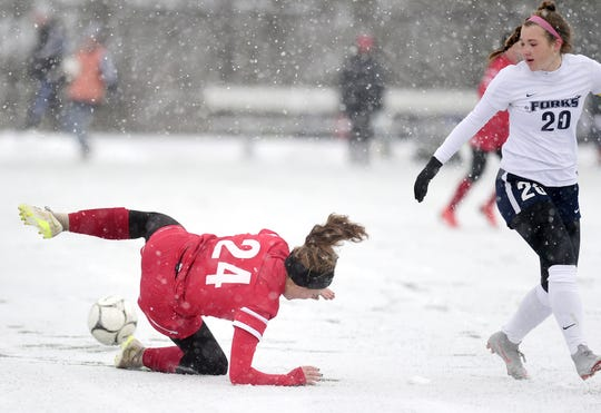 Wheatley's Julia Braito falls on the snowy field after attempting to take control of the ball from Chenango Forks' Emma Bough during the first half of Chenango Forks' 2-0 victory in the Class B girls soccer semifinals at Cortland High School, on Saturday.
