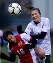 Allyson Camacho (18) of Valley Stream South and Emilia Cappellett (1) of Vestal battle for control during Vestal vs. Valley Stream South, NYSPHSAA Girls Soccer Championship, Tompkins Cortland Community College, Dryden, NY. Saturday, November 10, 2018.