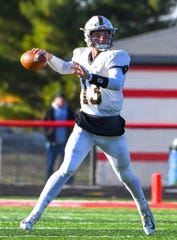 Evansville Central quarterback Brennon Harper attempts a pass against East Central in the IHSAA 4A Regional Playoffs at East Central High School, Saturday, Nov. 10, 2018, St. Leon, IN