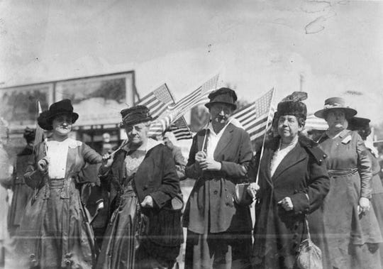 War Mothers leaders marching at first convention. Far right is Gertrude Schulz. To her left, is Alice Gresham Dodd, mother of James Bethel Gresham, one of the first U.S. casualties in WW I.
