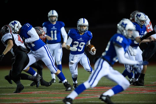 Memorial's Finn McCool (29) carries the ball to a first down against the Brownstown Central Braves in the Class 3A regional at Enlow Field in Evansville, Ind., Friday, Nov. 9, 2018.