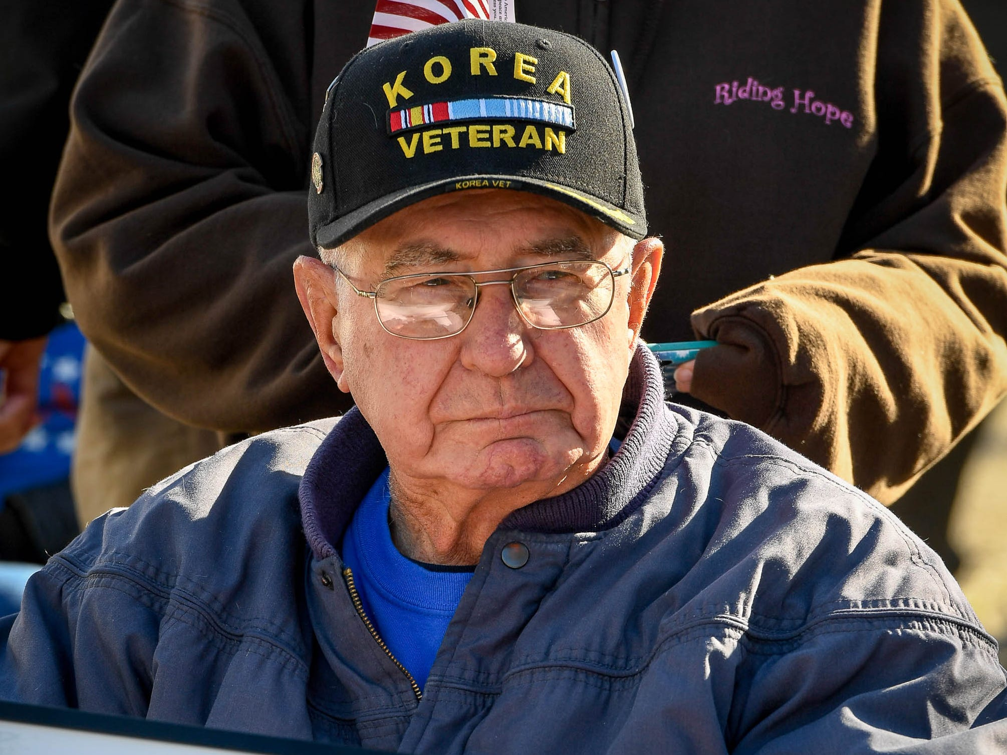 Marvin Lawrence Zwahlen, a Korean War veteran, waits for the start of the annual Four Freedoms Veterans Parade on Evansville's West Franklin Street Saturday. Zwahlen also proudly proclaimed he is the last name in the phone book, November 10, 2018.